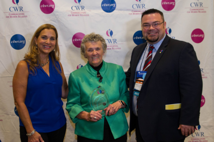 Stephanie Hall, CWR Board Member, Sister Joan holding her award from CWR, Nick Schafer, CWR Executive Director.