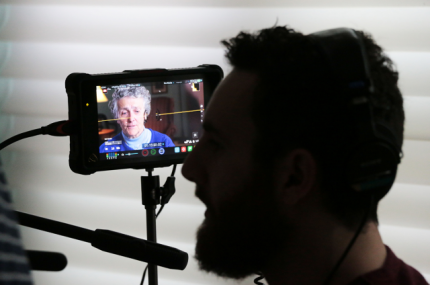 A member of the film crew monitors the recording. Photos by Jo Clarke, oblate