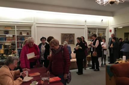 Sister Joan signs books after her presentation at Lockport, NY