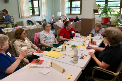 Twenty-four participants engage in conversation at the Joan Chittister Institute for Contemporary Spirituality